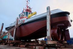 Tug Boat in Dry Dock. Unique view of a large tug boat in dry dock Royalty Free Stock Photo