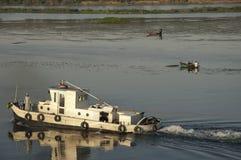 Tug boat and fishing boats Stock Photo