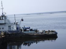 The Tug boat floats on the river.  Stock Photo