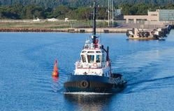 Tug boat goes on a fairway in Porto-Vecchio Stock Photos
