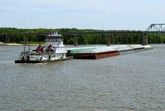 Tug boat and grain barge stock image