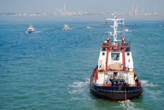 Tug Boat Guides in Cruise Ships in Venice Grand Canal Royalty Free Stock Photography