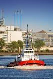 Tug boat in port. Tug boat navigating a harbor river in late sun Royalty Free Stock Photos