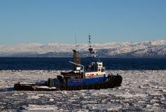 Tug boat pushing through ice Royalty Free Stock Photography