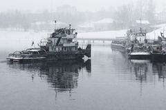 Tug boat on the river in the snow Royalty Free Stock Photos
