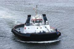 Tug boat at sea stock image