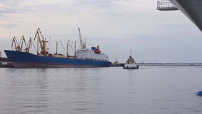Tug-boat at the sea trading port timelapse. Tug-boat at the sea trading port time lapse (Full HD stock footage