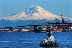 Tug Boat Seattle Port with Red Cranes and Boats Bridge Mount Rai Royalty Free Stock Image