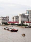 Tug boat service on CHAO  PHRAYA river BANGKOK, THAILAND pulling heavy floating container Royalty Free Stock Photography