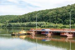 Tug boat sets section of the pontoon bridge Royalty Free Stock Photography
