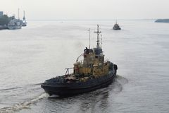 Tugs works in the port stock photos