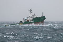 I believe I can Fly - even haevy and steel. A tug boat ship is jumping from the water due to heavy stormy weather while passing Cape of Good Hope stock photography