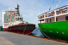 Tug boat and ships Stock Photos