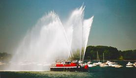Tug boat sprays water canon. Royalty Free Stock Photography