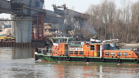 Tug Boat Turn Around on Vistula River. Tug boat turn around on the Vistula river in Warsaw, Poland stock footage