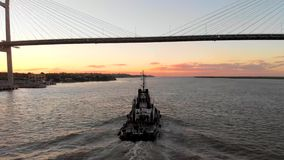 Tug boat under Rosario-Victoria Bridge, Santa Fe, Argentina. Tug boat under Rosario-Victoria Bridge, Santa Fe, Argentina, sailing along the Paraná River stock footage