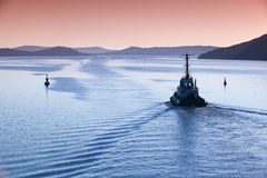 Tug boat underway on fairway Royalty Free Stock Image