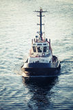 Tug boat underway, front view, tonal correction Stock Photos