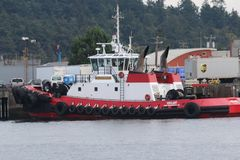 Crowley Tug `Vigilant`. Tug boat on the waters of the Puget Sound Stock Photo