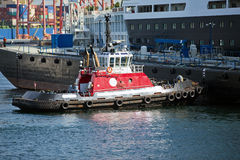 Tug Boat at Work. Tug boat in the harbour in Vancouver, British Columbia, Canada royalty free stock image