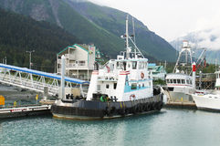 Tug Boats. A Tugboat in a small fishing port Royalty Free Stock Photo