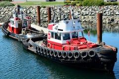 Tug boats docked Stock Image