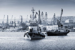 Tug boats are working in Varna harbor. Black Sea Stock Photography