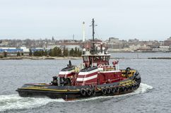 Tug Buckley McAllister New Bedford waterfront. New Bedford, Massachusetts, USA - April 8, 2018: Tug Buckley McAllister passing Palmer Island in New Bedford royalty free stock photo