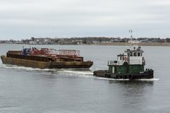 Tug Bucky towing equipment barge Stock Photography