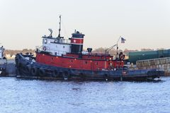 Tug `CO` docked Stock Images