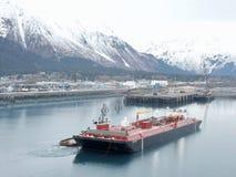 Tug escort into Alaskan port royalty free stock photos