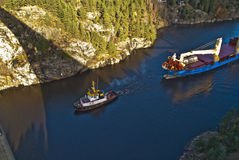 Tug hebert are towing bbc europe out of the fjord Royalty Free Stock Photography