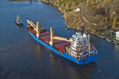 Tug hebert are towing bbc europe out of the fjord Royalty Free Stock Photo