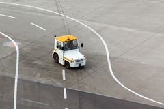 Tug and luggage on the airport tarmac Stock Photo