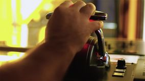Tug master controls motors. Close-up of hands in a low light. HD stock footage