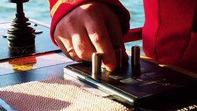 Tug master controls ship rudder. Close-up of hands. Tug master controls motors. Close-up of hands stock footage