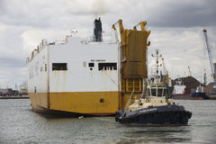 Tug pulling car carrier ship Southampton Docks Stock Photography