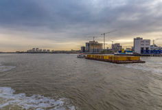Tug pulling load of containers on the River Thames Stock Images