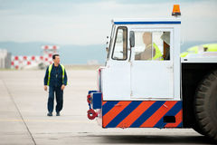 Tug pushback tractor in the airport. Royalty Free Stock Image