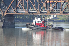 Tug and Railway Bridge Royalty Free Stock Photo