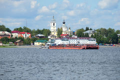 The tug Rechnoy 76 with a barge against the city's historic centre. Ferry in the city of Myshkin. Yaroslavl regio Stock Photos