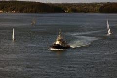 Tug and sailboats Royalty Free Stock Image