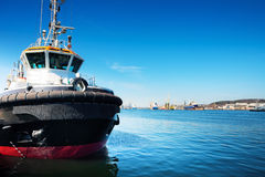 Tug ship. Small tug ship in port, Gdansk / Poland. Shipyard in the background royalty free stock photography