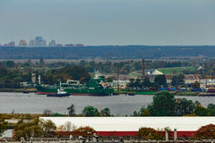 Tug ship moving past the cargo port Royalty Free Stock Photo