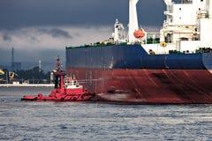 Tug with ship Stock Photo