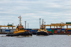 Tug ships. In the cargo port of Riga, Europe stock images