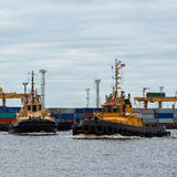 Tug ships in port Stock Images