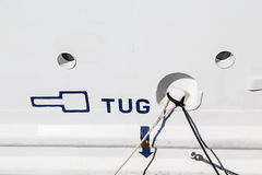 Tug Sign on a White Ships Hull Royalty Free Stock Photos