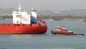 Tug and tanker Royalty Free Stock Image
