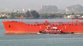 Tug and tanker Stock Image